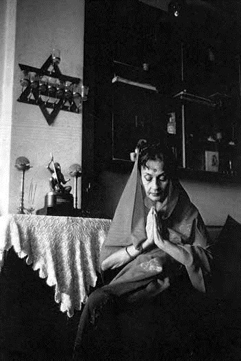 Joan Roth's photograph of the actress Nadira with the Star of David and a statue of Devi Mahatmya behind her.