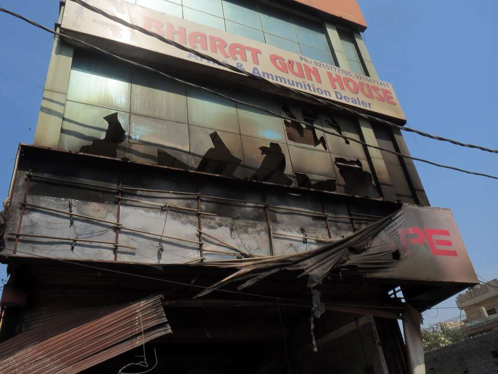 A store selling ammunition and guns was ransacked and burnt in Rohtak.