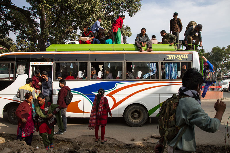 When the fuel crisis hit Kathmandu, passengers were forced to ride on the roofs of crowded buses. But the police started to issue fines to stop the practice.