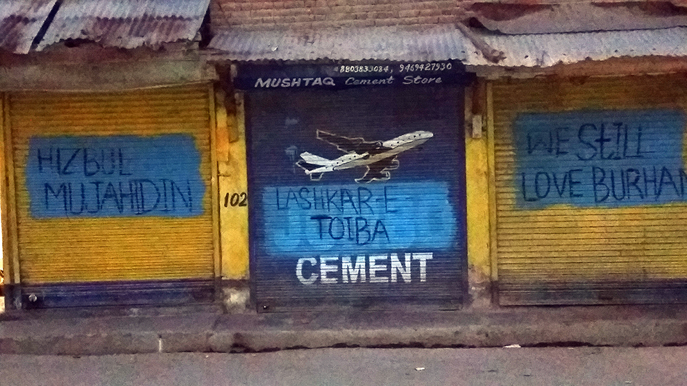 Graffiti on shops in old town, Baramulla