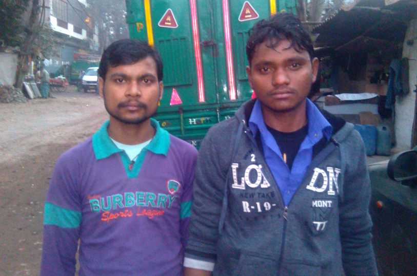 Vinod Kumar (left) does not have a bank account but is banking on his friend Manoj (right), who has one.