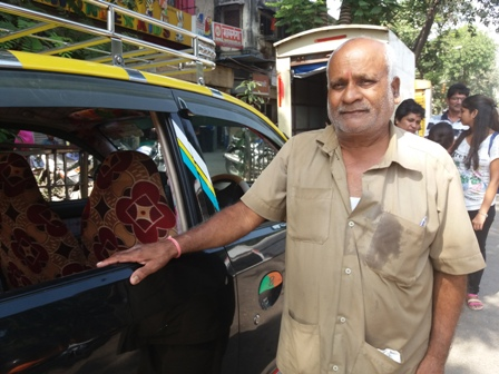 Ambeshah Sharma with his taxi.