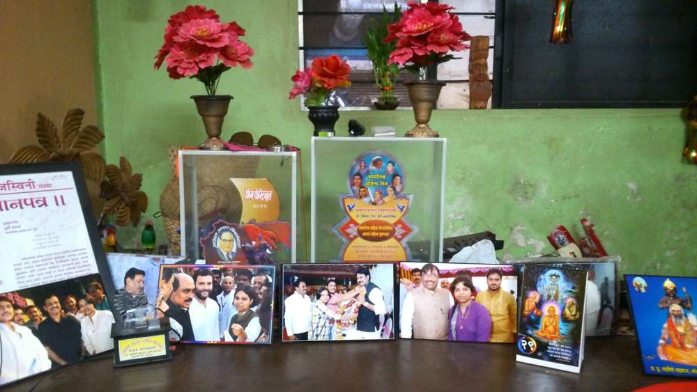 Photographs and awards in Trupti Desai's office.
