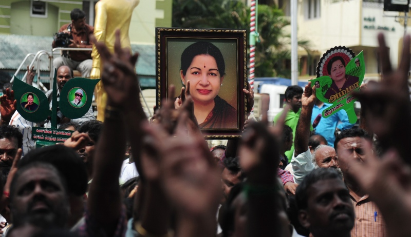 Members of the AIADMK carry placards with the image of Jayalalithaa as they celebrate the party's victory in the Assembly polls in May 2016 in Chennai. (Photo credit: AFP/Arun Sankar)