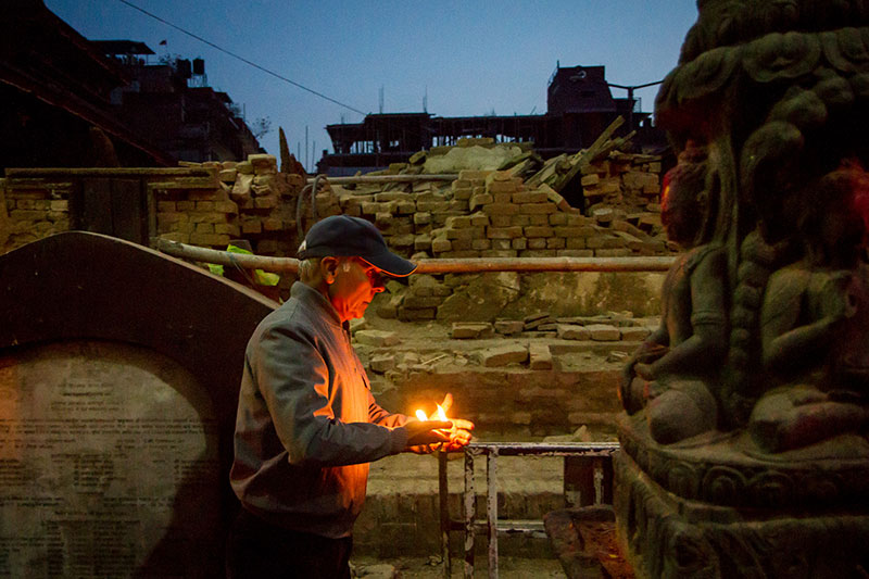 A man offers prayers at a shrine in Kathmandu Durbar Square.