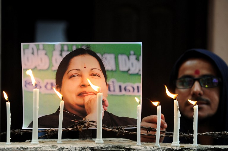 Supporters light candles in memory of the leader in Allahabad.