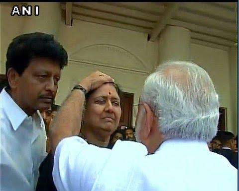 Narendra Modi consoles Jayalalithaa's close aide Sasikala Natarajan as she mourns the leader's death.