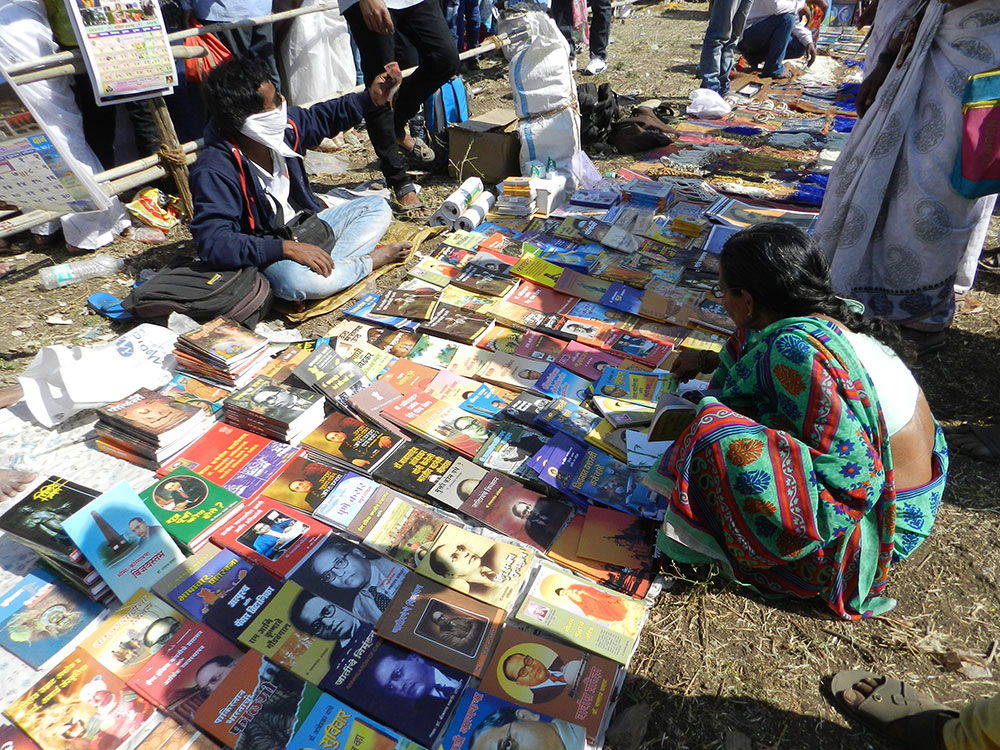 A woman browses at a book vendor. Photo credit: Mridula Chari
