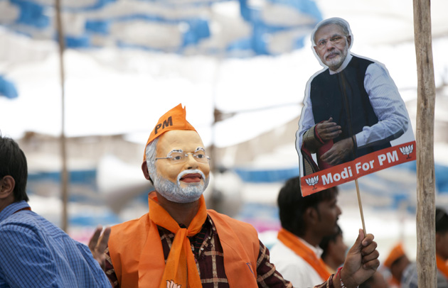 A man wearing a Modi mask. Credit: Wikimedia Commons