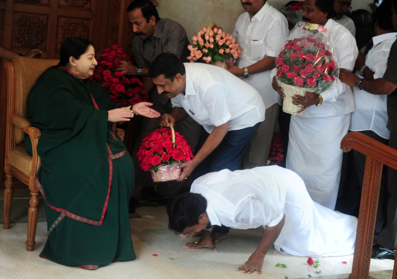 A party member prostrates himself at the feet of J Jayalalithaa at her residence in Chennai following the party's victory in the Assembly elections in May. (Photo credit: AFP/Arun Sankar).