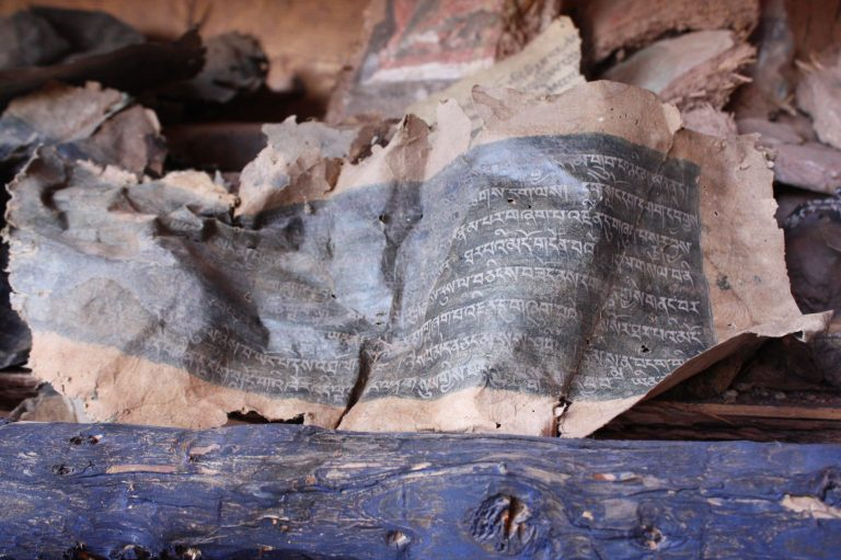Ancient Buddhist scriptures and relics from a looted pagoda. Credit: Wang Yan