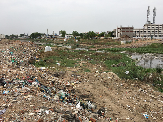 Garbage is dumped alongside the river. Photo by M Rajshekhar.