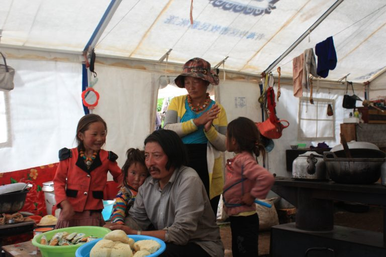 Luo Zhu and his family in their tent.