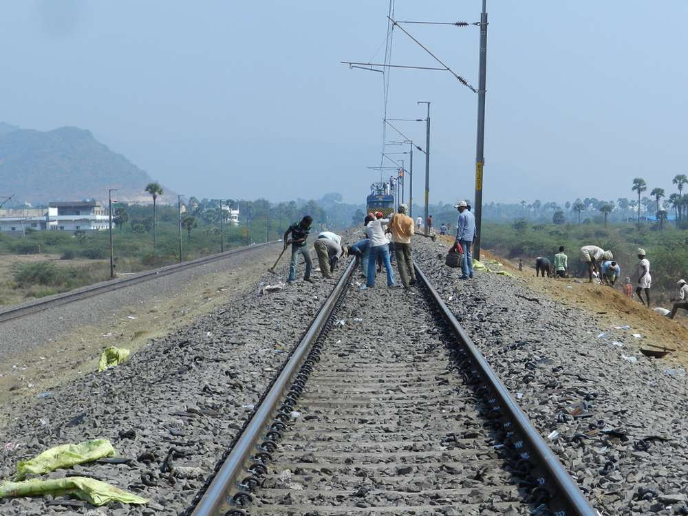 Workers get the tracks ready for traffic again.