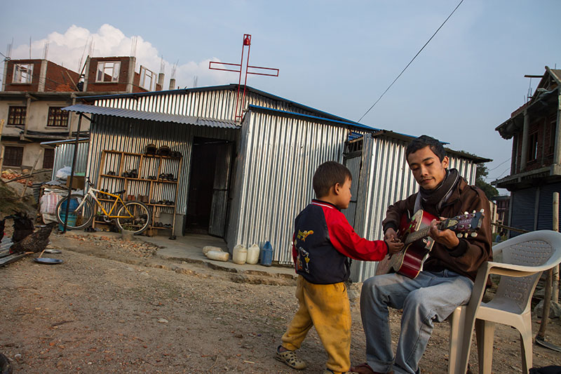 Before the earthquake, Ashish Gurung lived with his parents in a rented brick house, where they ran a church and a orphanage. Today, they feel much safer, sleeping on the floor of the tin-sided church they have built in Kavresthali, outside Kathmandu.
