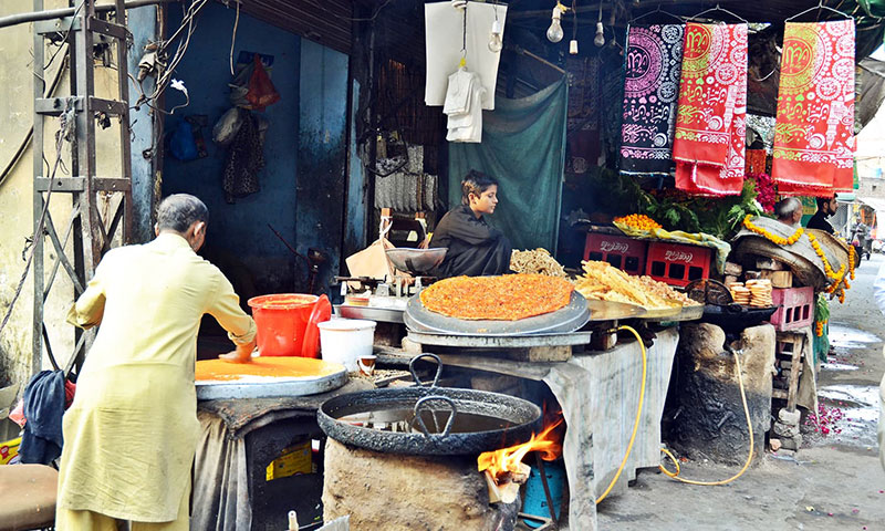 Vendors sell food near the shrine. Photo by Abdullah Khan.