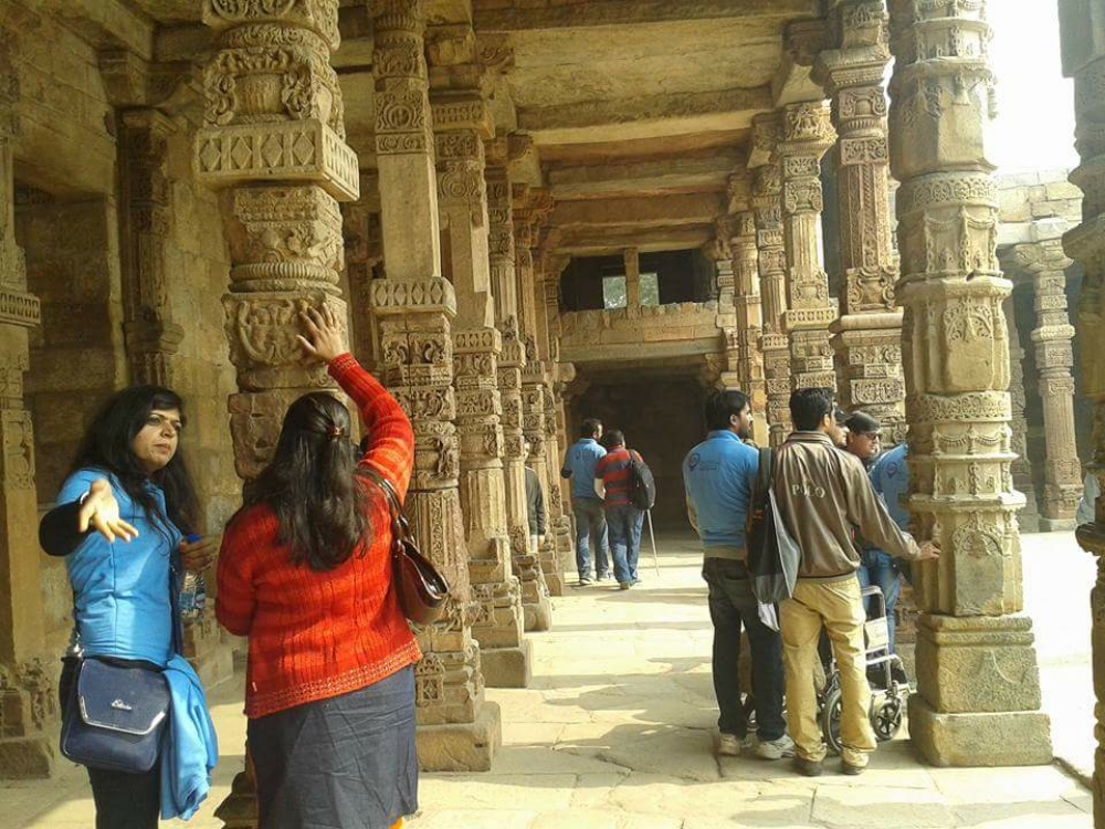 During the Qutub Minar excursion, visually impaired participants get a sense of the complex by touching the carvings and inscriptions. (Photo courtesy: Planet Abled)