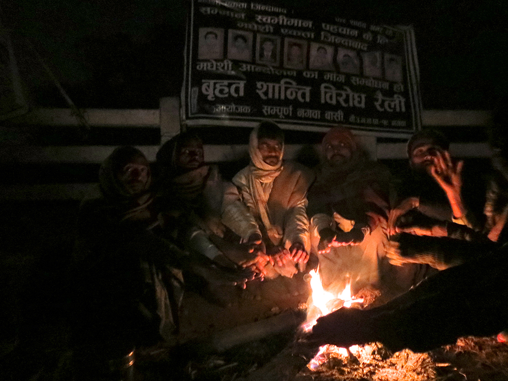 After a set of blankets went missing from the tent on January 16 the protesters protect themselves from the chill by lighting fires. Photo: Anumeha Yadav