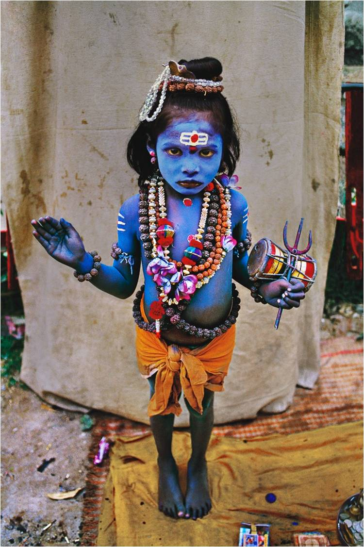 Young child, dressed as Lord Shiva, seeks alms, 1998. (Photograph by Steve McCurry. Courtesy Phaidon/Roli Books)