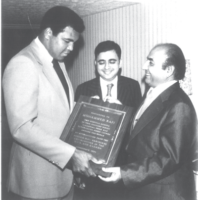 Boxer Muhammad Ali felicitates Rafi in Chicago during one of his tours. Courtesy Sujata Dev's 'Mohammed Rafi'.