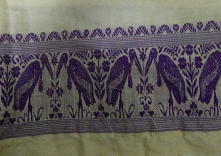 Traditional Assam silk textile with stork motif. Image Credit: Purinima Barman