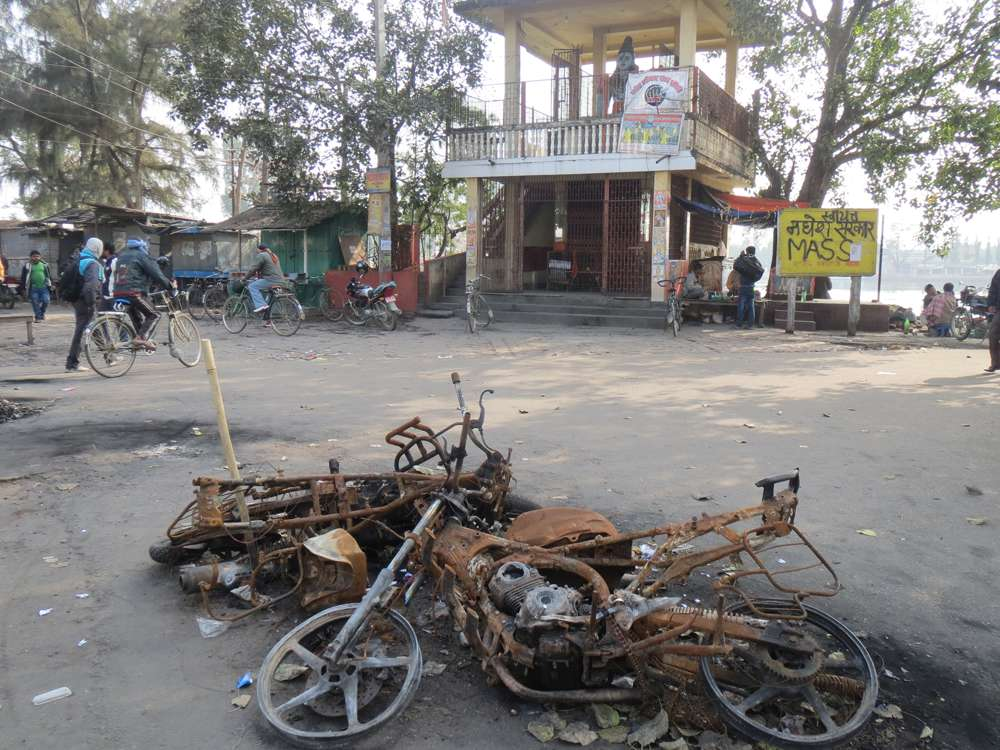 Charred motorcycles lie at a chowk in Janakpur, where a curfew was imposed after three youth died in police firing on January 21.