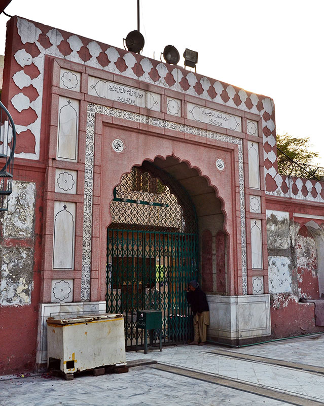 Like a lot of Islamic architecture, the shrine's gate bears Persian inscriptions. — Photo by Abdullah Khan.