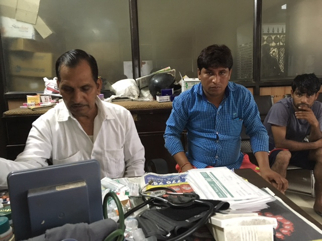 Veer Singh, who has a Ayurveda medicine degree, with his patients. Photo: Menaka Rao