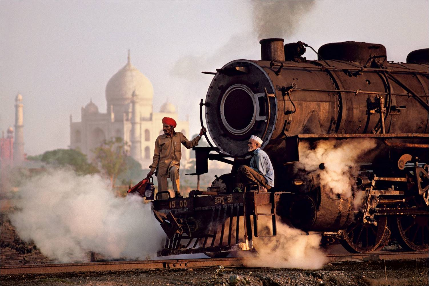 Steam engine passes in front of the Taj Mahal, 1983. (Photograph by Steve McCurry. Courtesy Phaidon/Roli Books)