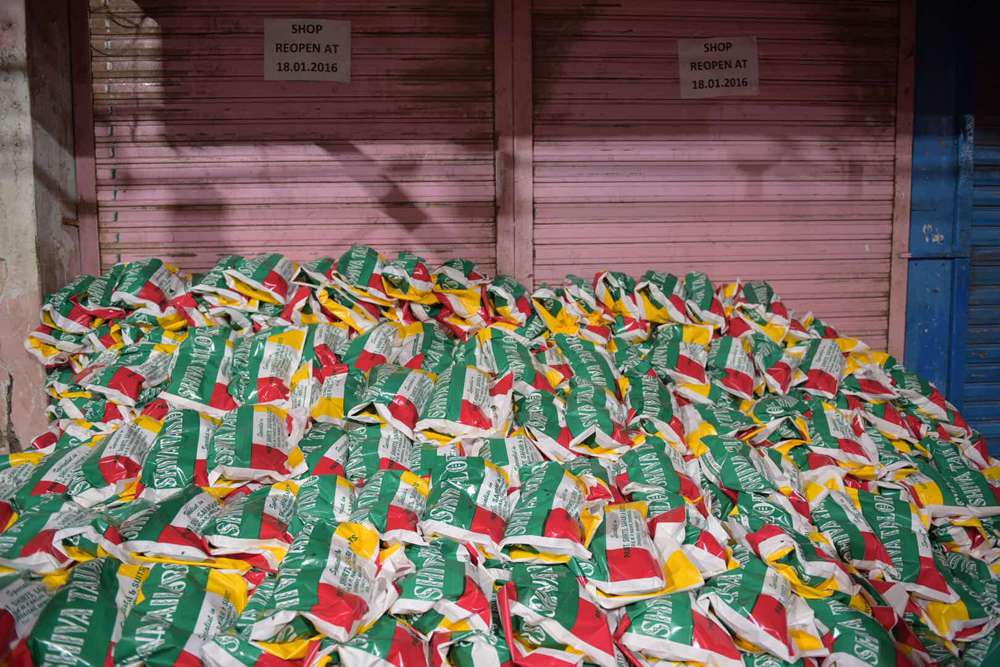 A thousand sacks of rice stand ready to be distributed.