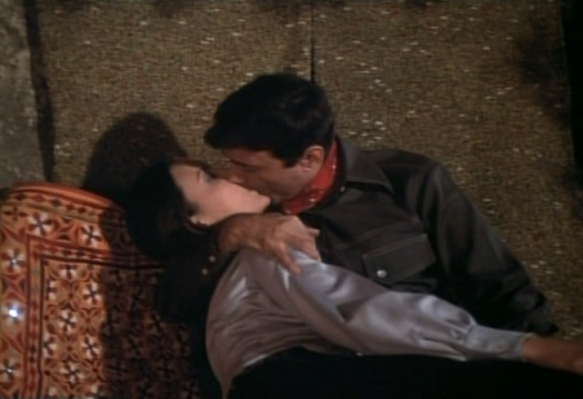 Dev Anand and Kieu Chinh in a liplock.