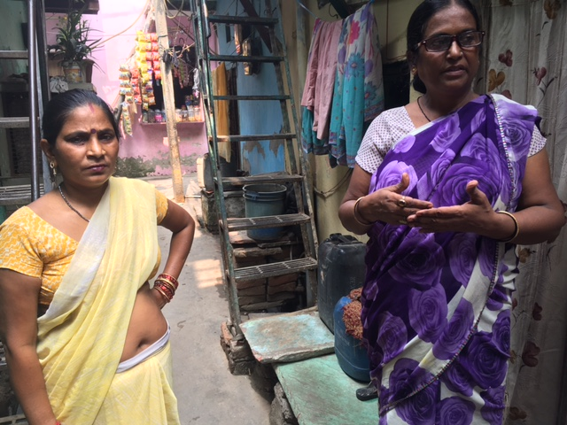 ASHA worker Neelam Chaudhary with Sukhba Devi who suffers from severe body ache. Photo: Menaka Rao.