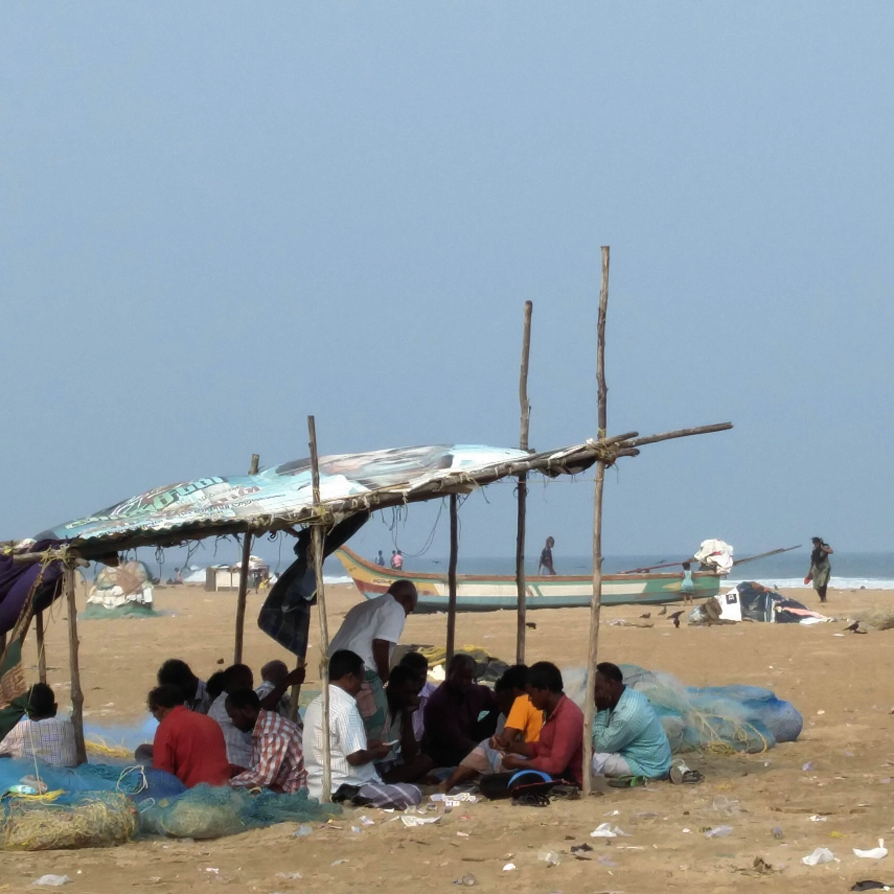 Fishermen play cards on Marina beach in Chennai.  (Photo credit: Vinita Govindarajan).