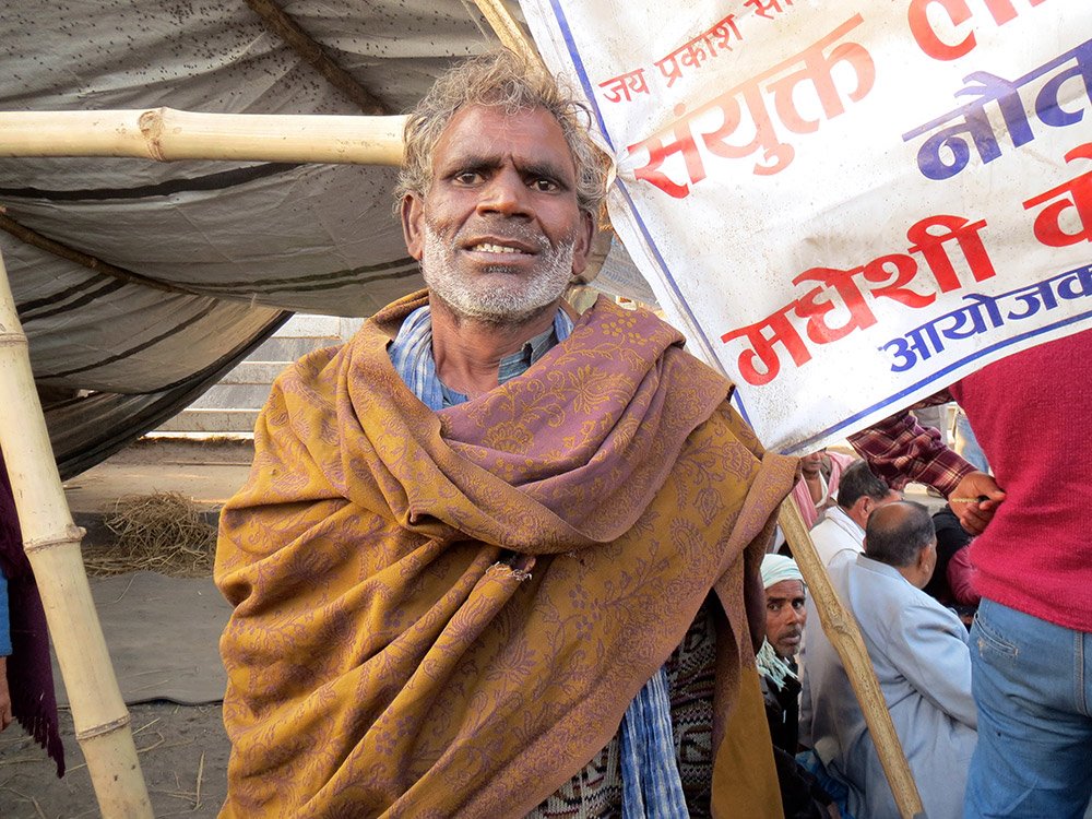 Dhola Sah, a farmer from Sisaniya village, has been protesting on the Maitreyi bridge since 115 days. Photo: Anumeha Yadav