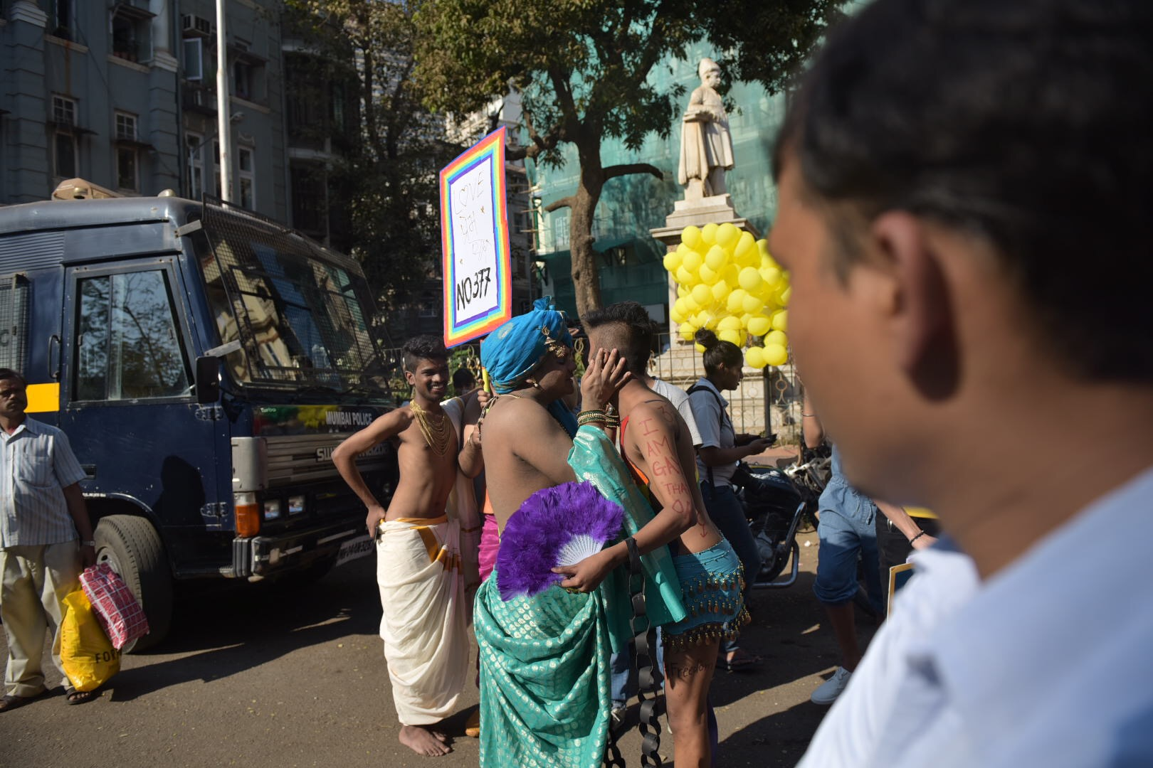 Participants at the Mumbai Gay Pride Parade greet each other enthusiastically.