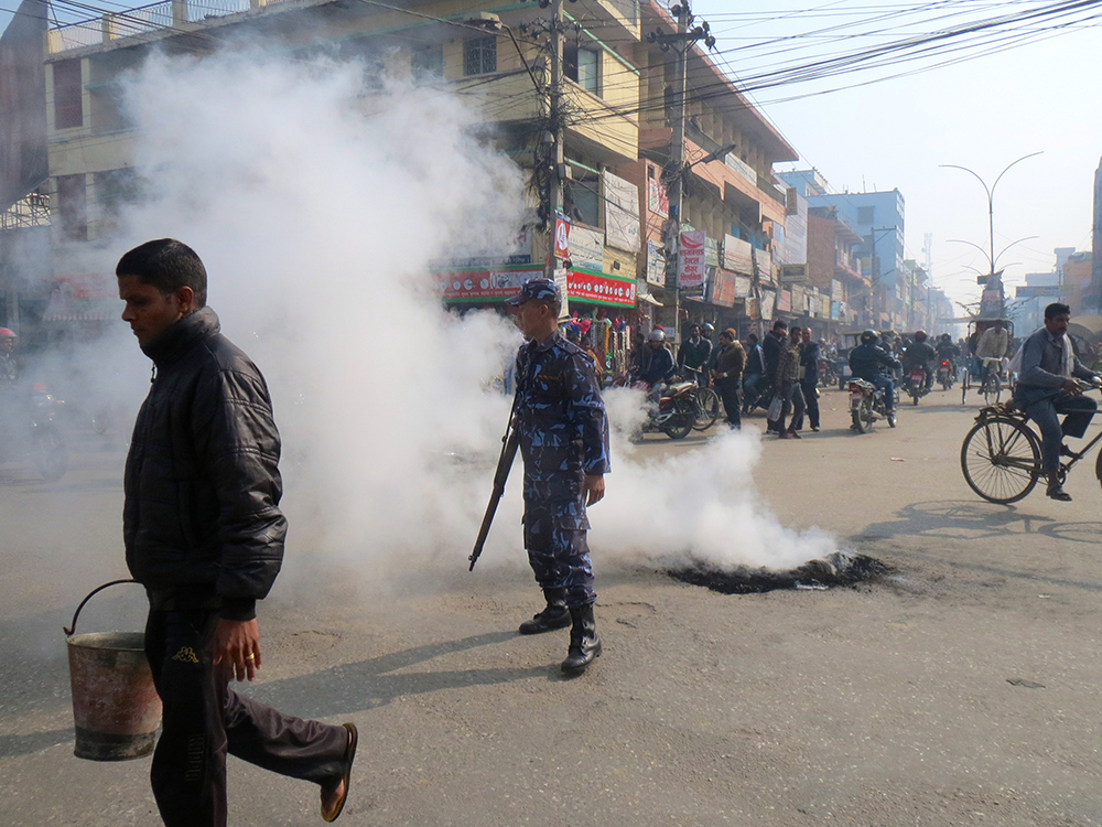 Protesters regularly burn tyres at cross roads across the town. Photo: Anumeha Yadav