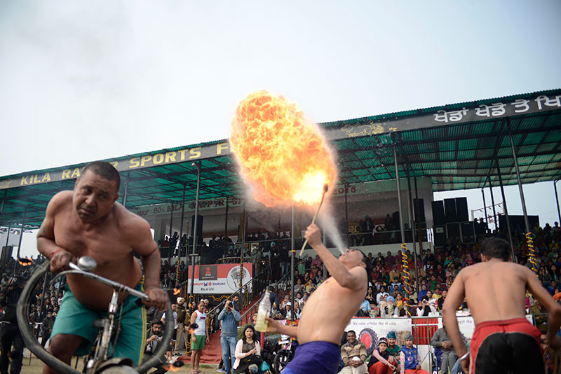 Locals display their fire-blowing skills.