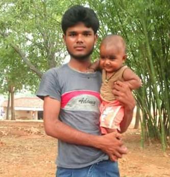 A recent photograph of Minhaj Ansari, with his daughter.