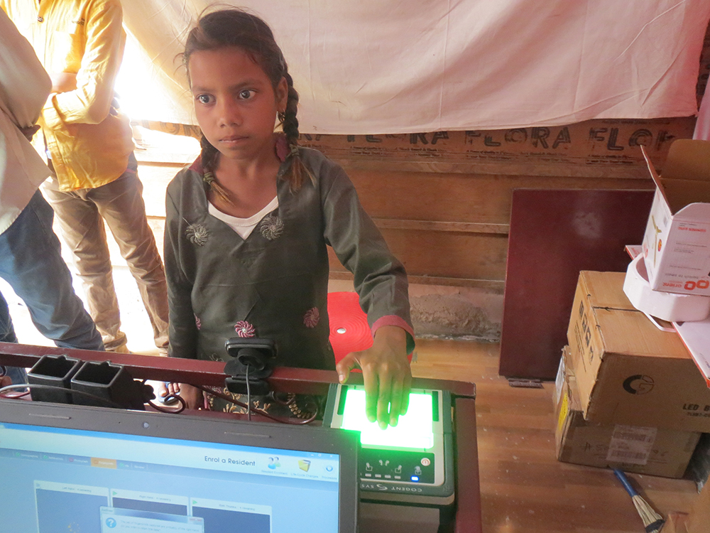 Nine-year-old Sanjana Bairwal enrolling in Aadhaar in Bagru, Jaipur district, after it was made compulsory for students to enrol in Aadhaar to access scholarships. Credit: Anumeha Yadav