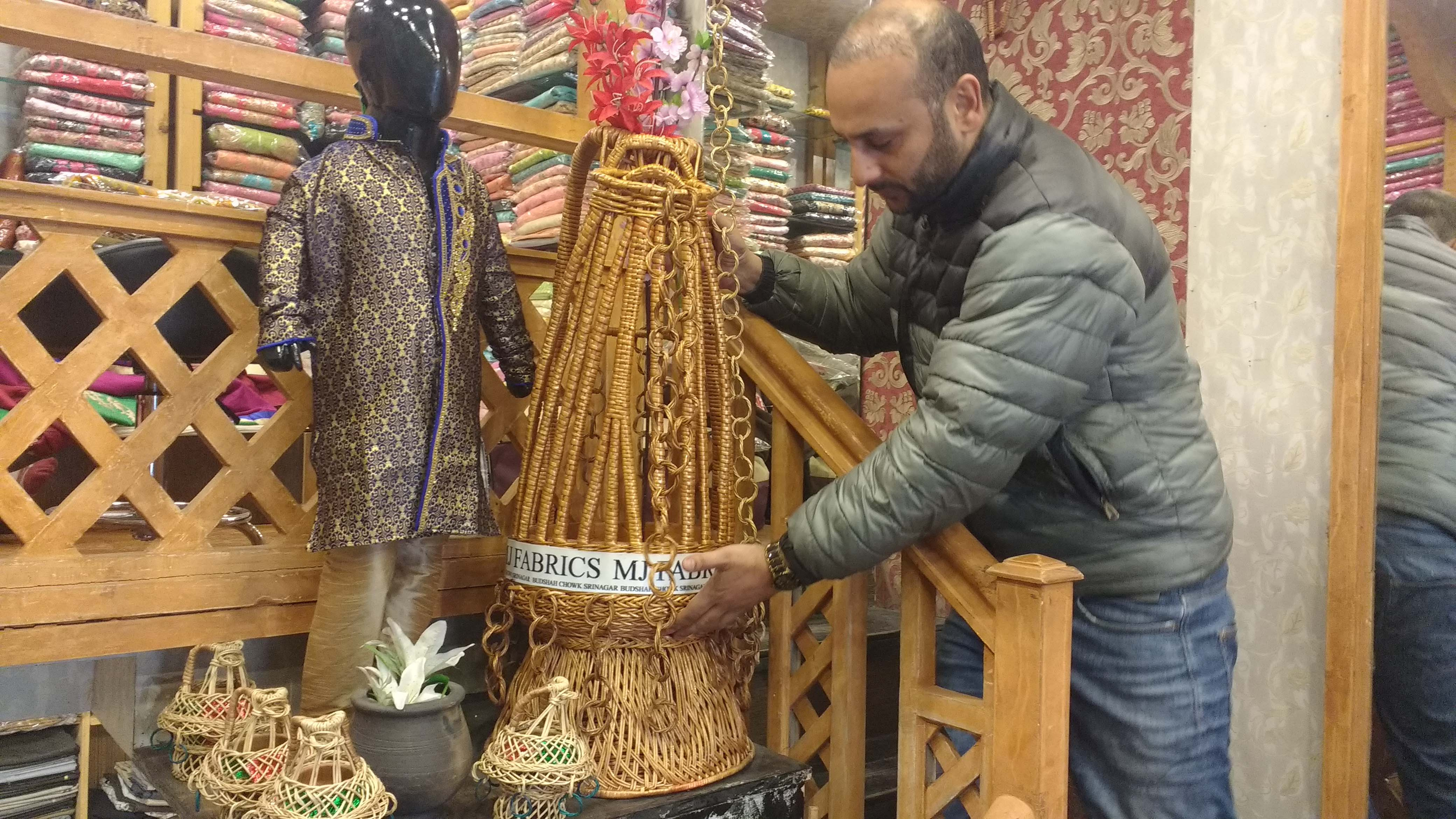 Junaid Handoo displays an oversized kanger in his fabric shop in Lal Chowk area. Photo: Rayan Naqash