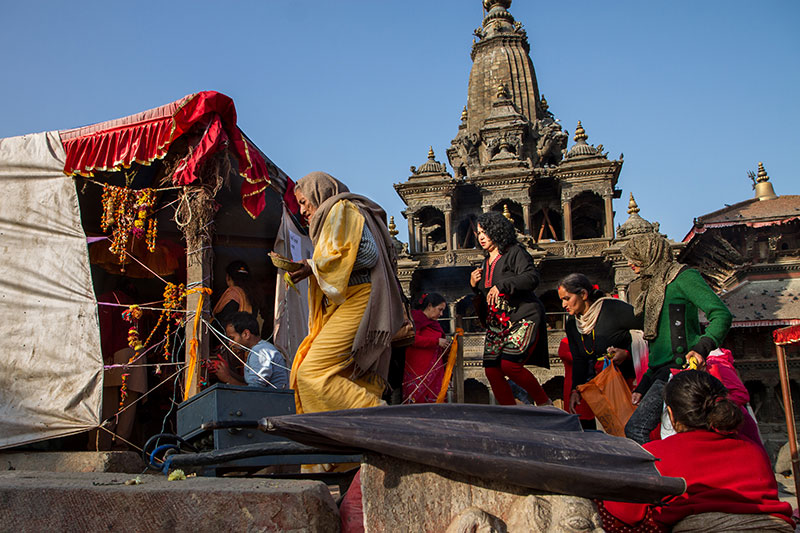 Devotees conduct a puja at the remains of the Char Narayan temple in Patan Durbar Square in the Kathmandu Valley. The 17th century temple, sacred to Vishnu and one of the oldest at the World Heritage site, was destroyed in last April's earthquake.
