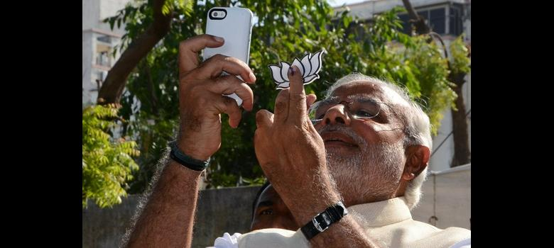 Modi booked for taking selfie with party symbol, making 'political speech' after voting