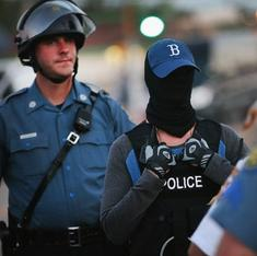 Ferguson shooting shows need for lighter policing, not heavier