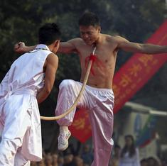 A brutal murder exposes the close ties between China's elite and their qigong mystics