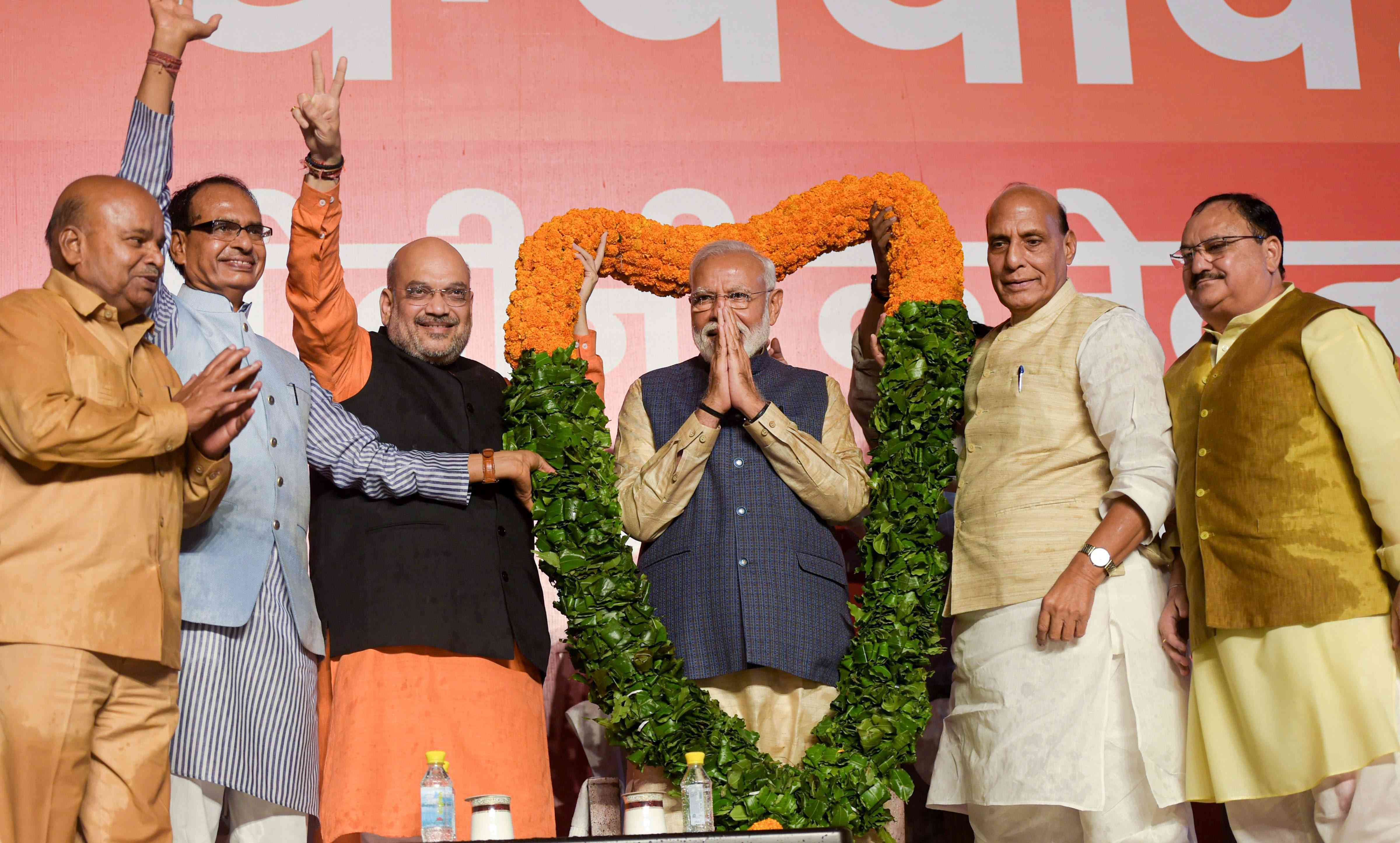 Prime Minister Narendra Modi (centre) and other senior BJP leaders celebrate the election victory at the party headquarters in New Delhi on Thursday. (Image credit: PTI)
