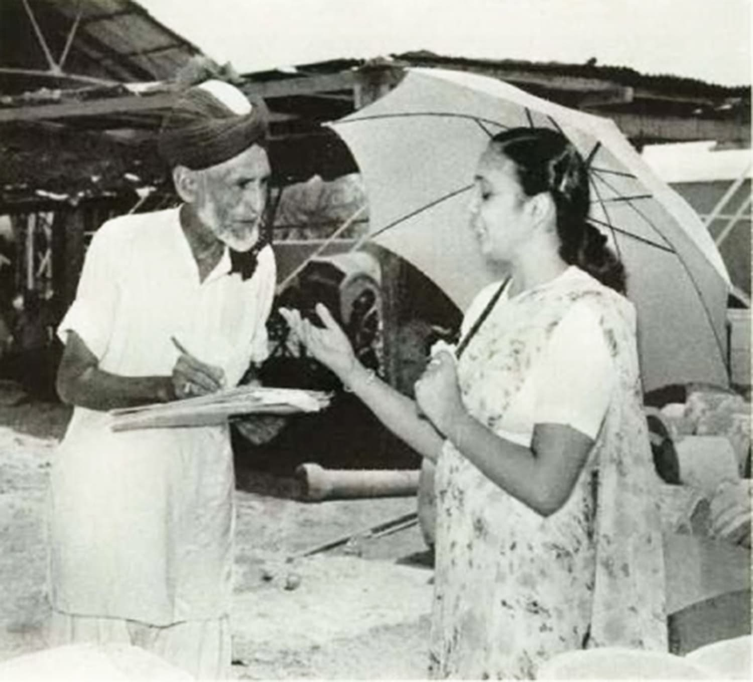 Pakistan's first leading female industrialist, Razia Ghulam Ali, giving instructions to an employee at her factory in Karachi. The Ayub regime had made Karachi the focus of its rapid industrialisation project.
