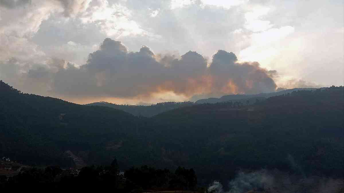 A smoky landscape after the fire in Vattavada, Munnar. Photo credit: Joby George