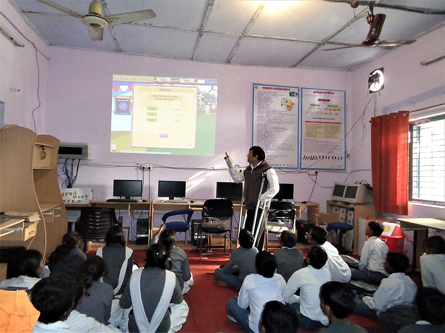 Negi using the school's projector during a class. (Photo credit: Pradeep Negi).