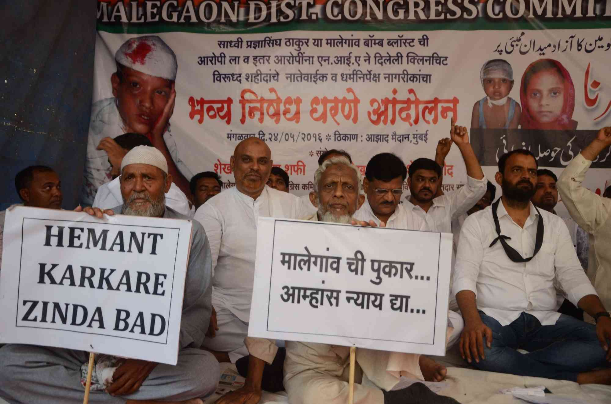 The Congress district committee in Malegaon, Maharashtra, organised a demonstration on Friday in protest against BJP leader and blast accused Pragya Singh Thakur's comments about Mumbai police officer Hemant Karkare. Credit: IANS