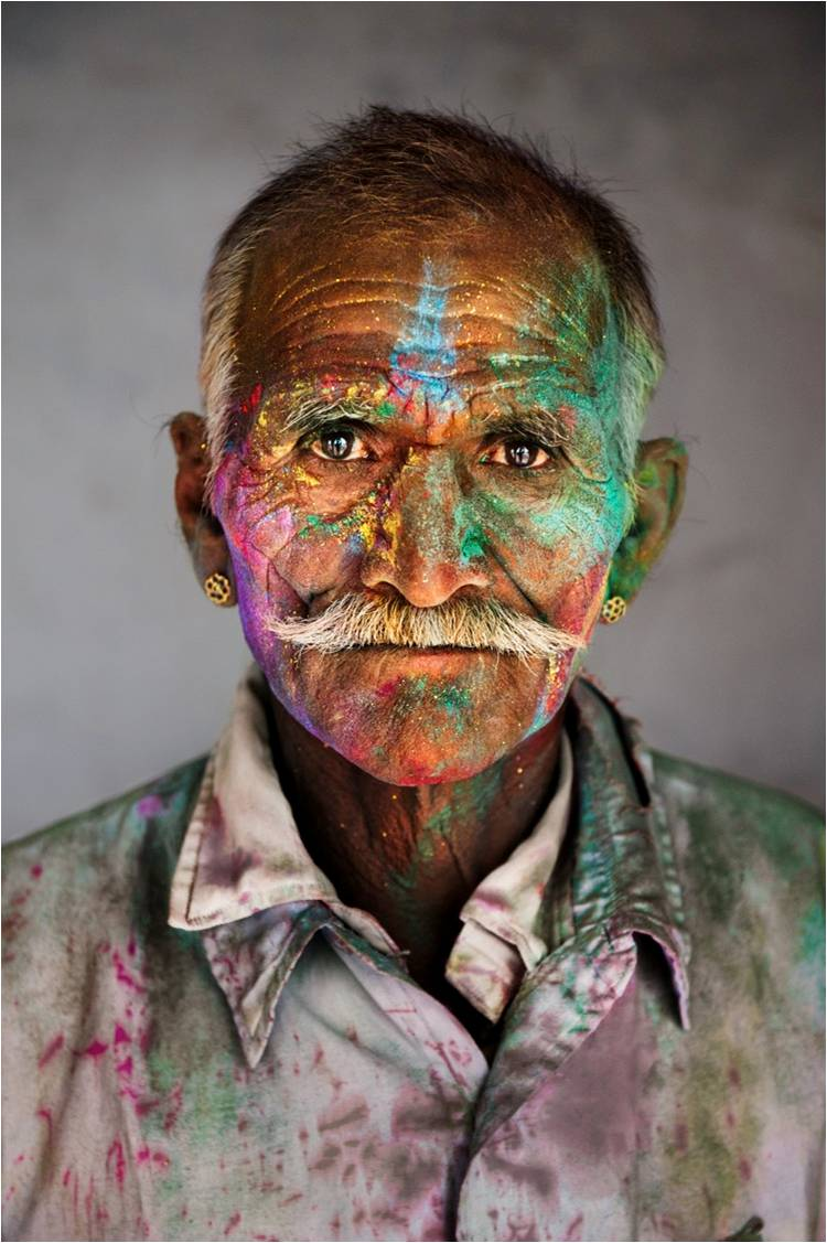 Man covered in gulal during Holi, the festival of colours, 2009. (Photograph by Steve McCurry. Courtesy Phaidon/Roli Books)